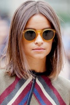 Miroslava Duma long bob straight hair. Hairstyle you should try to change your look. Simple and modern.
