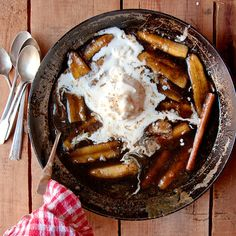 Bananas Foster-- Created in 1951 at the legendary Brennan's restaurant in New Orleans to honor Richard Foster, a friend of the restaurant and local businessman, this boozy, buttery concoction of caramelized bananas flambéed in rum sauce has since become a dining-out classic.