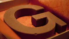 Edible Initials are a Delectably Sweet Solid Chocolate Gift Idea #wedding #weddingcake trendhunter.com