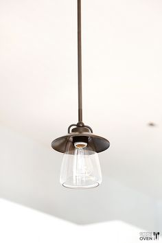 industrial kitchen pendant lights over peninsula - Google Search