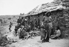 Boer Settlement Taken Over. A native South African family living inside of a British camp. Native families were rounded up and sent into concentration camps of their own to keep them from feeding Boer troops. An estimated 14,154 natives died in the camps. South Africa. Circa 1899-1902.