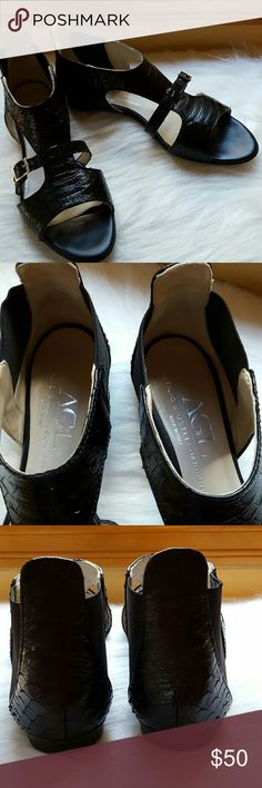 AGL Euro 2 Sandals Slender belts bridge the breezy side cutouts on a striking leather flat crafted in Italy by Attilio Giusto Leombruni. Tonal elastic insets near the heel perfect the fit and allow for quick on and off. Calfskin upper, rubber sole. Excellent condition! AGL Shoes Sandals
