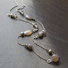 Another way to make a neutral necklace that will go with everything.  Plus, I can use up some beads that have just been hanging around.....Agate and glass bead long necklace