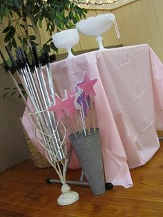 Have either wands and swords or have them decorate princess hats and crowns.