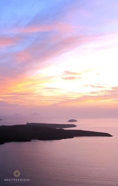 The Santorini volcano at sunset. For luxury hotels in Santorini visit http://www.mediteranique.com/hotels-greece/santorini/