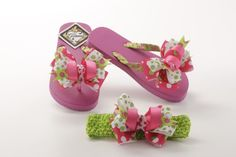 """These Gitana Flip Flops are decorated with ribbons as well as a beautiful bow. Included matching green headband with silk flower lined clipper. Headband approximately 1 1/2""""or 2 1/2""""inches depend the stock ."""