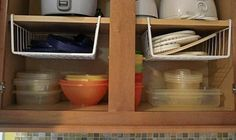 12 Easy Kitchen Organization Tips | Hanging shelf dividers help utilize vertical space.