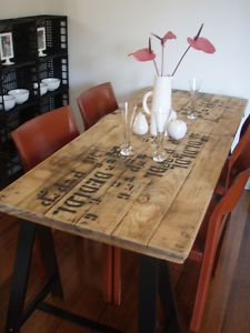 upcycling old boards into a gorgeous table.  Loving this table, think I may have to find some of these of my own