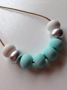 Beautiful soft pastel mint with white teamed with silver hand crafted beads all strung onto tan greek leather and finished with a sliding knot so size can be adjusted. Beautiful with a plain white or grey tee for that weekend lunch with the girls.