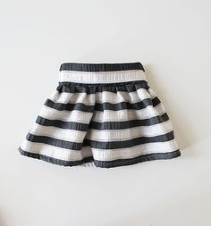This skirt is made with woven polyester fabric.All seams are professionally serged for durability.  Detailed with a pleated front and high quality elastic waistband in the back.  Please note, these skirts are handcrafted, therefore, pattern placement may vary slightly from the skirt pictured.  Also for different screens as in phone screens, computer screens, etc. may not always depict colors exactly as you see them in person. Care instructions: Machine wash, delicate c...