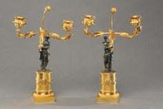 Paire de candélabres en bronze doré et bronze patiné brun re