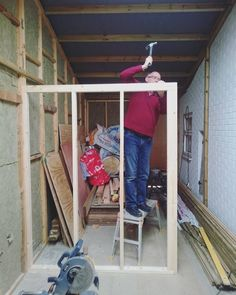 """Been a very busy weekend starting to build the internal structure. Here's my dad putting the final nail in what will be the back wall of my kitchen. This will also support my """"floating"""" bed........ #selfbuild #selfbuilt #diy #conversion #tinyhousemovement #tinyhousdesign #flexibleliving #wood #timbre #carpentry #woodwork #architecture #interior #Studio22 #tinyhouse"""