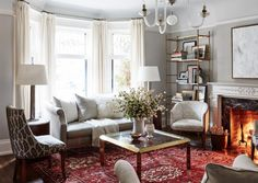 Allison Willson Portfolio, Sarah Richardson Design. Light gray walls, red rug and neutrals