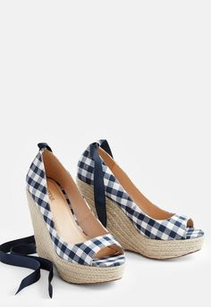 Elevate your summer style with these super trendy espadrille wedges with a gingham print and lace-up closure....