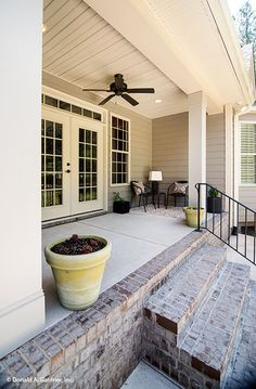 French doors open to this serene back #porch. The Weatherford - Plan 1053. http://www.dongardner.com/house-plan/1053/the-weatherford. #OutdoorLiving #HomePlan