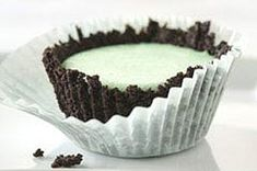 A chocolate sandwich cookie crust is pressed into muffin cups, filled with a minty marshmallow mixture and then frozen for mini dessert treats.