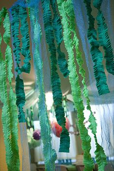 "seaweed tissue streamers..cute hanging from front door to carry guests ""under the sea."""