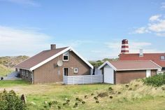 Three-Bedroom Holiday Home Ørredvej with a Sauna 02 Thisted Featuring a terrace, Three-Bedroom Holiday Home Ørredvej with a Sauna 02 is a holiday home located in Nørre Vorupør in the Nordjylland Region.  The kitchen is fitted with a dishwasher. A TV is provided.