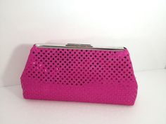 A personal favorite from my Etsy shop https://www.etsy.com/listing/153344802/hot-pink-sequin-disco-ball-clutch-with