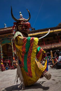 Ladakhi monk dressed in folkloric costume is dancing at the annual Tsechu festival in Hemis gompa, Ladakh, Jammu and Kashmir, India.