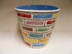 Colorful Fratelli Fanciullacci planter with vibrant door RetroVases