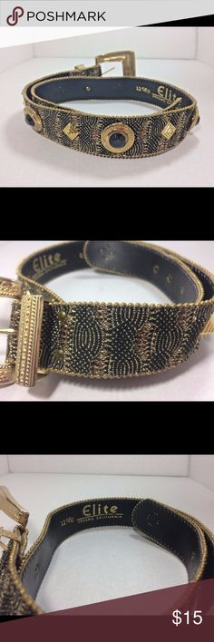 VTG Gold Embellished Fabric Overlay Belt Vintage belt for women made with embellished fabric and detailed with decorative gold. The golden detail on the black belt looks outstanding.   Pre owned in great vintage condition. The overlay fabric has great stitch and touch.  Color : Black and gold.  Buckle Color : Gold elite Accessories Belts