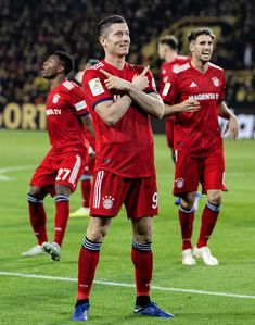 Robert Lewandowski of FC Bayern Muenchen celebrates after scoring his. Signal Iduna, Football Pictures, Team Pictures, Fc Bayern Munich, Robert Lewandowski, World Football, San, Celebrities, Soccer Teams