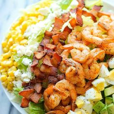 Ingredients  1 pound medium shrimp peeled and deveined  2 tablespoons olive oil divided  campaignIcon Coupons  1 tablespoon Emeril's Essence Creole Seasoning  4 slices bacon diced  2 large eggs  5 cups chopped romaine lettuce  1 avocado halved seeded peeled and diced  1 cup canned corn kernels drained  1/2 cup crumbled goat cheese  For the Cilantro Lime Vinaigrette  1 cup loosely packed cilantro stems removed  Juice of 1 lime  1 jalapeño optional  2 cloves garlic  Kosher salt and freshly…