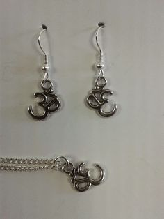 These om charms are only £3.99 for either pendant or earrings, or £6.99 for a set - including a gift box.