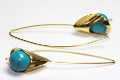 Impressive turquoise gem stone hook earrings, sterling silver rhodium and goldplated by FavelaJewelry on Etsy