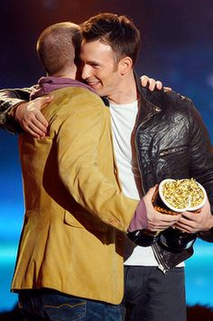 Joss Whedon and Chris Evans accept Best Fight award for 'Marvel's The Avengers' onstage during the 2013 MTV Movie Awards