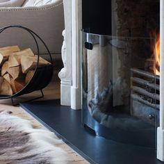 this glass fire guard is a brilliant idea. Enjoy watching the flames while keeping prying fingers away
