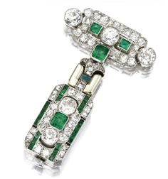Platinum, emerald, and diamond pendant-watch, french, movement by Patek Philippe, circa 1930. Via Southeby's.