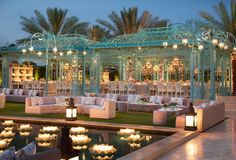 An outdoor wedding with iron and floating lotus flowers makes for an unforgettable wedding venue. Pool Wedding, Dubai Wedding, Wedding Lounge, Mauritius Wedding, Wedding Reception, Cancun Wedding, Wedding Stage, Indoor Wedding, Green Wedding