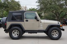 """2003 """"Khaki Metallic"""" Jeep Wrangler Sport - $13,995 - 136k Miles, 5-Speed Manual, Soft Top, 33"""" Mud Terrain tires, Call for a Test Drive 281-338-1989. http://www.selectjeeps.com/inventory/view/8869248/2003-Jeep-Wrangler-2dr-Sport-League-City-TX"""
