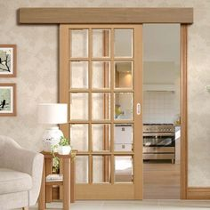 Thruslide Surface SA 15L Oak - Sliding Door and Track Kit - Bevelled Clear Glass - Lifestyle Image. #glazeddoors #barndoors