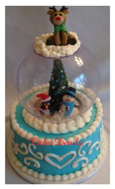 snow globe cake from www.cakedevils.com