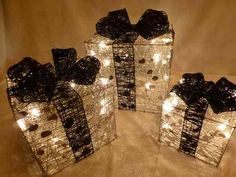 three light up Christmas decoration presents