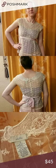 """Odille Romantic Lace Top 19"""" across bust 16"""" across waist  12""""  camisole length  20"""" length  Condition is very good.  It ties at the waist and buttons at the back. Camisole is attached to the outer lace top. Anthropologie Tops"""