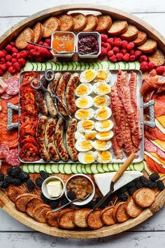 Serve an Epic Grilled Breakfast Charcuterie Board filled with grilled meat, chee. Serve an Epic Grilled Breakfast Charcuterie Board filled with grilled meat, cheese, and soft boiled eggs. Add fruit and summer jams for easy entertaining. Grill Breakfast, Breakfast Platter, Breakfast Buffet, Snack Platter, Breakfast Fruit, Meat Platter, Sweet Breakfast, Breakfast Casserole, Charcuterie Recipes