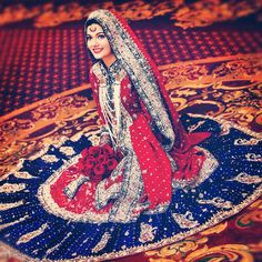 A hyderabadi muslim bride wearing a non traditional sharara but with the traditional pearl strands. I really like the high collar for a hijabi bride!