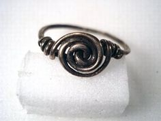 Silver wire spiral finger-ring. Anglo-Saxon 5th-7th century.