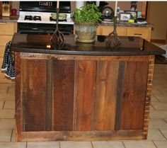 Kitchen island made out of reclaimed barn wood.