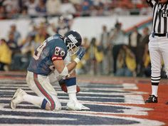 ONE OF THE BEST TIGHT ENDS EVER...Super Bowl XXI (Giants 39, Broncos 20): New York Giants tight end Mark Bavaro kneels down after catching Phil Simms' touchdown pass in the third quarter.