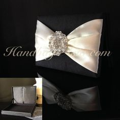 Black silk wedding invitation box in luxury look with rhinestone brooch