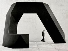 "Tony Smith with ""Cigarette"" installed in the garden of the Museum of Modern Art. New York, 1979"