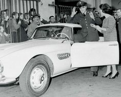 Elvis in uniform with his BMW 507
