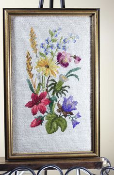 """Lovely, vintage, hand made needlepoint art. Framed and ready to hang. Dimensions: 11-1/4"""" (W) 17-3/4"""" (L)"""