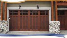 I wonder how this garage door would look on our house?  Have been wanting to fence off an area to the right.  It could be the same wood tone with an arbor.  I would also add a second post on either side of porch and would clad the posts in the same wood tone.