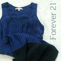 """Color Block Dress Color block dress in indigo and black. Very interesting crinkly fabric. Fully lined. Side zipper closure. 100% polyester. Length 35"""" Bust 38"""". Excellent condition! love 21 Dresses"""